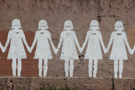 Paper doll graffiti in a public street. Rome. Photo credit to The Plaid Zebra.