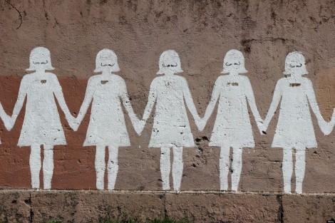 Paper doll graffiti in a public street. Rome. Photo credit to The Plaid Zebra.