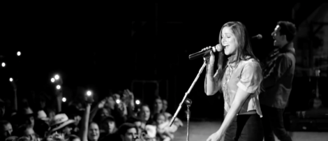 "Cassadee Pope performing in a live black-and-white video performance of Bon Jovi's ""Bed of Roses."""