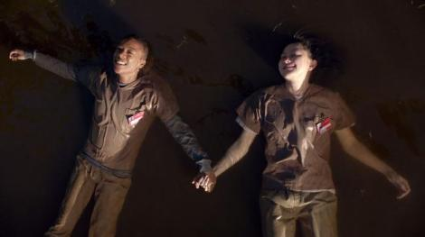 Poussey (Samira Wiley) and Soso (Kimiko Glenn) float in the lake. Courtesy of Netflix.