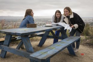 Actors Kaitlyn Dever and Beanie Feldstein with director Olivia Wilde on the set of her directorial debut, BOOKSMART, an Annapurna Pictures release. (Credit: Francois Duhamel / Annapurna Pictures)